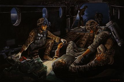 Military Medics treating a casualty on a Chinook helicopter during a night operation