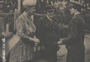 Queen Mary hands badge QAIMNS(R) to sister passing out Dame Louisa J Wilkinson Matron In Chief